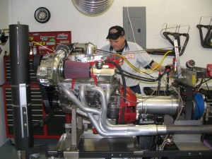 Dean is preparing to pull this supercharged 900 horse power small block Chevy engine on our 901 Super Flow dyno. All of our high performance engines are run on our dyno to ensure maximum performance is realized.